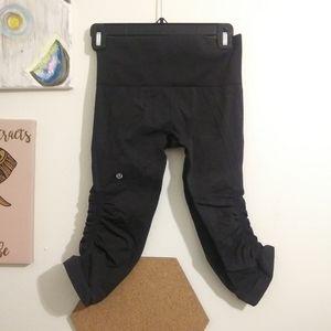 Charcoal Lululemon capris leggings. In the flow